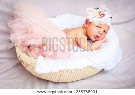 A Sweet Unhappy To Be Awaken Newborn Infant Baby Girl. A Surprised And Upset Look. A Tiny Newborn Gi
