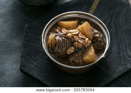 Close View Of Massaman Curry With Rice, Dark Background Copy Space