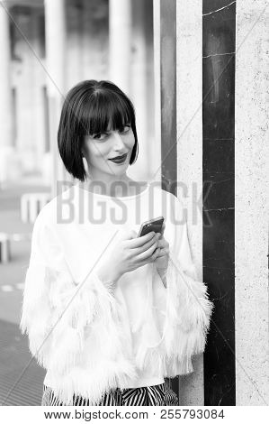 Woman With Brunette Hair Hold Mobile Phone. Woman With Red Lips Use Smartphone In Paris, France. Bea