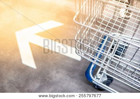 Shopping Cart (trolley) Over Go Forward Arrowhead Sign On The Floor In Supermarket Or Grocery Store.