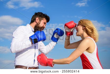 Man And Woman Fight Boxing Gloves Blue Sky Background. Defend Your Opinion In Confrontation. Couple