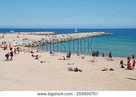 BARCELONA, SPAIN - APRIL 17, 2018: People enjoying the beach of the Capital of Catalonia.