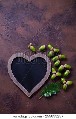 autumn mood chalkboard and acorns