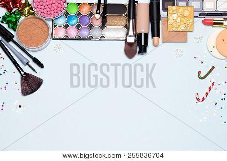 Christmas Makeup Cosmetics Background. Foundation, Powder, Blusher, Color Glitter Eyeshadow, Mascara