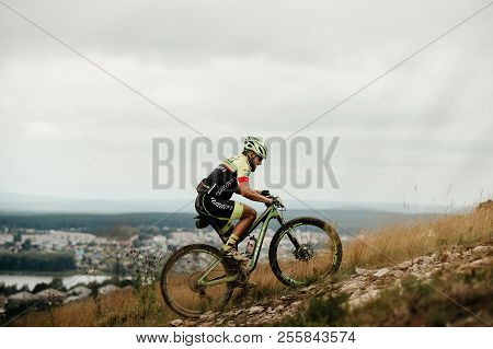 V.ufaley, Russia - August 12, 2018: Athlete Cyclist Mountain Biker Riding Uphill During Race Xcm Big