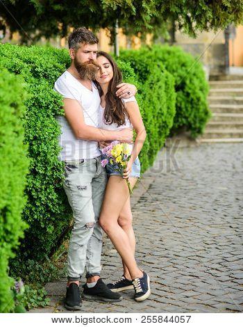 Man Bearded Hipster Hugs Gorgeous Girlfriend. Couple In Love Romantic Date Walk Nature Park Backgrou