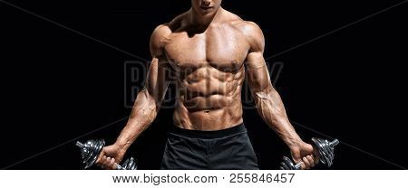 Sporty Man Working Out With Dumbbells. Photo Of Muscular Naked Torso On Black Background. Strength A