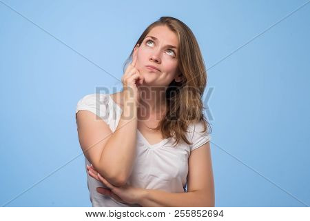 Close Up Portrait Of Pretty Confident Thoughtful Girl Looking Like Conspirator Standing Over Grey Ba