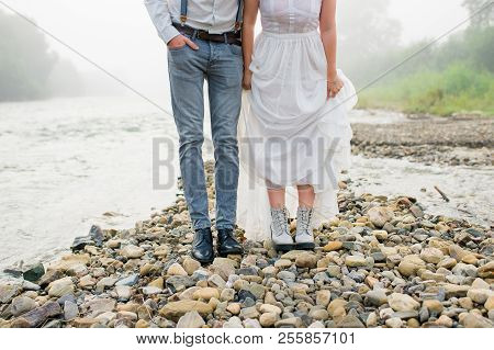 Beautiful bride and groom. Just merried. wedding couple.close-up wedding shoes. bride and groom in mountains, beautiful nature, landscape, fog