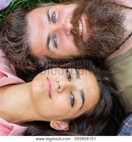Couple In Love Relaxing Lay At Meadow Close Up. Hipster Bearded Man And Girl Happy Carefree Enjoy Re