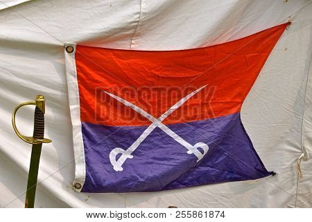 A unique flag or banner of the Civil War era is displayed in front of a tent for an officer (a re-enactment) poster