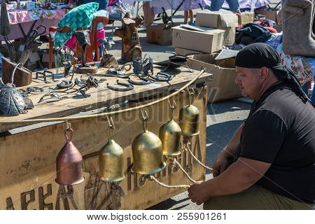 A Man Plays On Metal Bells At The Regional Festival-fair Luk-luchok August 25, 2018 In The City Of L