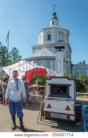 A Young Man At A Russian Mobile Stove At The Regional Festival-fair Luk-luchok August 25, 2018 In Th