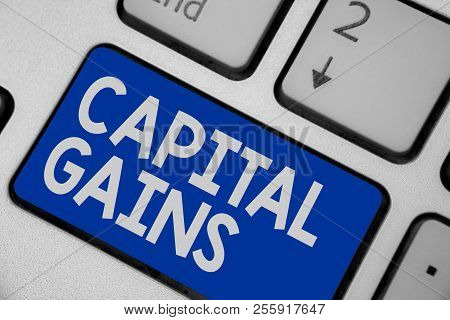 Writing Note Showing Capital Gains. Business Photo Showcasing Bonds Shares Stocks Profit Income Tax