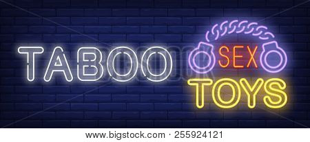 Taboo Neon Sign. Glowing Bar Sex Toys Lettering And Handcuffs On Brick Background. Night Bright Adve