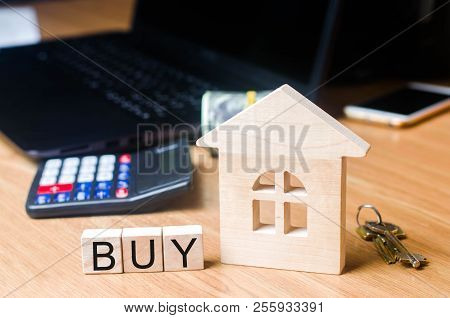 The House On The Desk Of The Realtor. Buying And Selling Real Estate. Acquisition Of Property And In