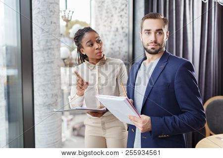 Two Co-workers And Important Documents. Business Concept