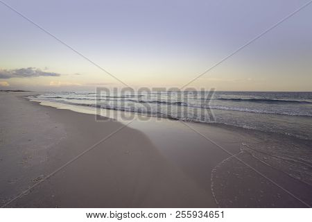Wide Angle Seascape At Dawn At Pensacola, Florida Beach. Pink, Mave And Soft Grays And Blues.