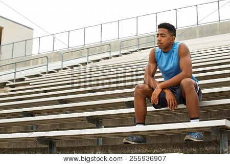 Young African Amerian Teenage Athlete Thinking About His Future.
