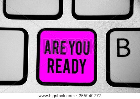 Conceptual hand writing showing Are You Ready. Business photo text Alertness Preparedness Urgency Game Start Hurry Wide awake Keyboard purple key Intention create computer reflection document. poster