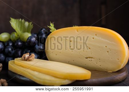 Dutch Hard Cheese Maasdam Or Emmentaler, Cheese With Holes And White Hard Goat Cheese . Whole Cheese
