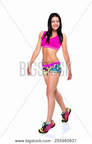 Portrait of slim fitness cheerful girl with perfect fit body in studio over white background. Fitness, weight lose, fitness diet, workout programs for women concept.