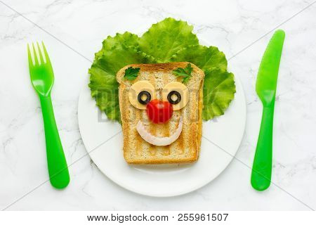Creative Sandwich For Kids Healthy And Funny Breakfast. Clown Face Fried Sandwich With Green Salad,