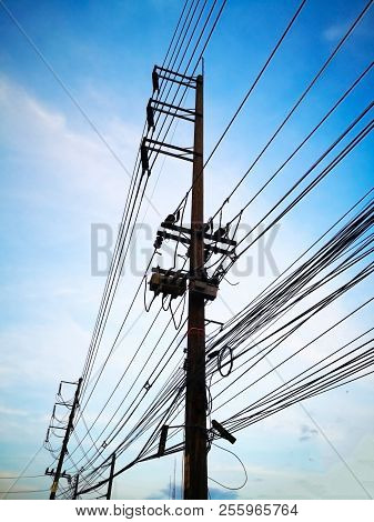 Three-phase Electric Poles On Road Side, That Is Common In Thailand. The Electric Lines, Telephone L