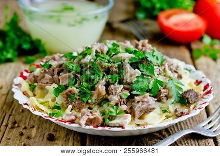 Beshbarmak National Kazakh Dish - Egg Noodles With Boiled Meat, Onion And Cilantro Greens Served Wit