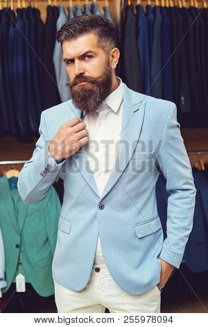 Portrait Of Sexy Man With Beard In Blue Suit