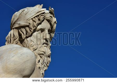 Greek or Roman God. Marble head of River Ganges statue from baroque Fountain of Four River, erected in the 17th century in the historic center of Rome (with copy space) poster