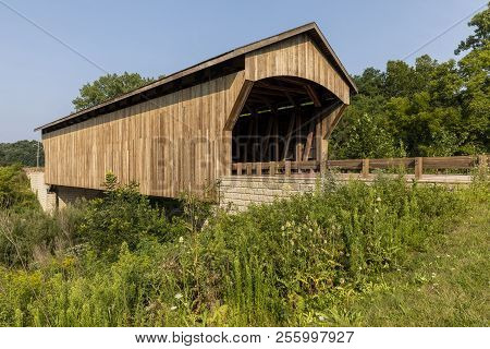 Brown Wooden Covered Bridge - A Covered Bridge On A Rural Road.