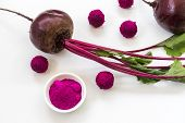 Bliss Balls coated in Beetroot and Dragonfruit Powder with Beetroot in Background poster