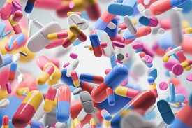 Yellow, Blue, Red And Green Pills And Their Combinations Falling Over Blurred Pills Background. Conc