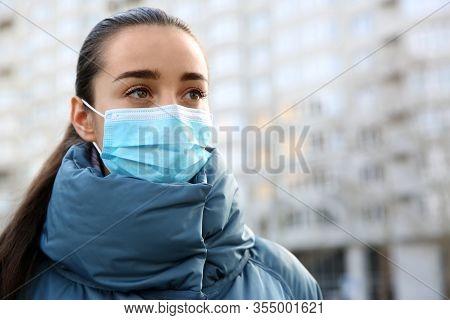 Woman Wearing Disposable Mask Outdoors. Dangerous Virus
