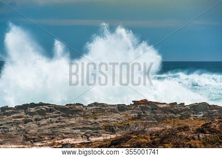 An Enormous Wave Crashing Against The Rocks At Storms River Mouth, Tsitsikamma National Park, South