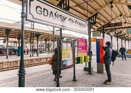 Passengers Waiting For A Train At The Platform Of Gdansk Glowny Railway Station Skm. Platform Of Mai