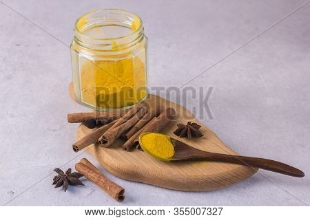Ingredients For The Preparation Of Golden Milk - Turmeric, Cinnamon On A Gray Background