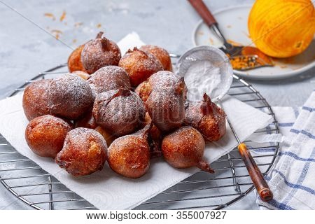 French Beignets With Powdered Sugar And Orange Zest.