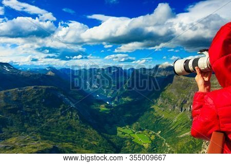Tourism Vacation And Travel. Female Tourist Taking Photo With Camera, Enjoying Geiranger Fjord And M