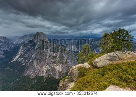 View Of The Half Dome And Yosemite Valley From Washburn Point. Sierra Nevada Mountain, The Yosemite