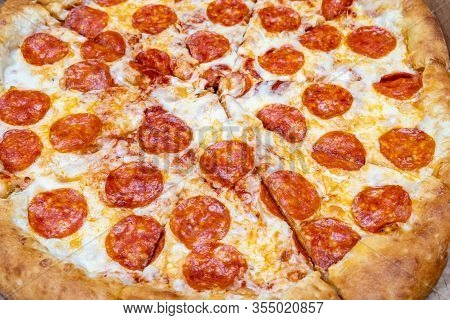 Hot Delicious Italian Pepperoni Pizza Close Up Background.