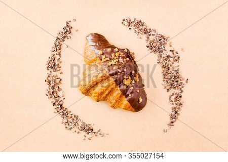 Classic Dark Chocolate Croissant And Cocoa Nibs On Brown Background. Sweet Food Design Banner.