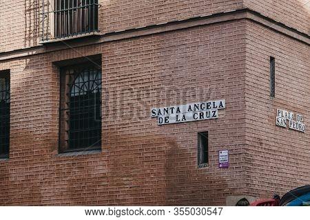 Seville, Spain - January 17, 2020: Street Name Sign On A Wall In Santa Angela De La Cruz In Seville,