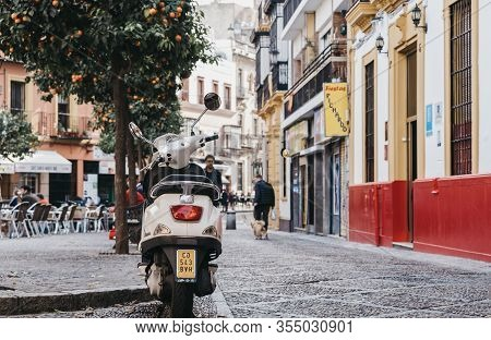 Seville, Spain - January 17, 2020: Vespa Motorbike Parked On A Paved Street In Seville, The Capital
