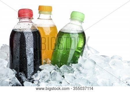 Ice Cubes And Different Soda Drinks On White Background