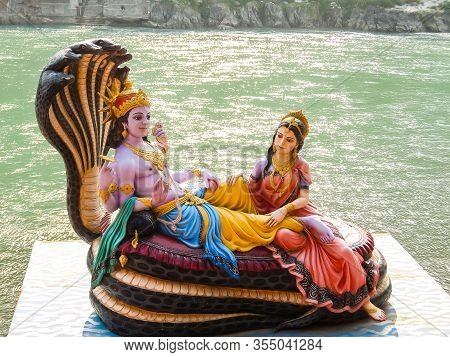 Rishikesh, India - Circa March 2018. Beautiful Statues Of Lord Vishnu And Lakshmi At The Ganga River