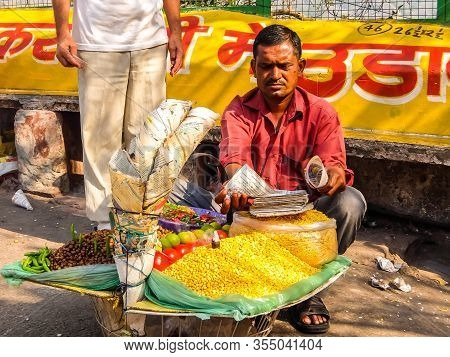 Rishikesh, India - Circa March 2018. Man Selling Food On The Street Of Rishikesh.
