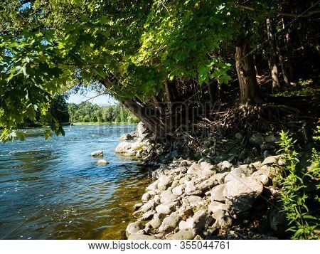 Beautiful Natural River With Trees And Rocky River Bank Near Toronto, Ontario, Canada. Tranquil And