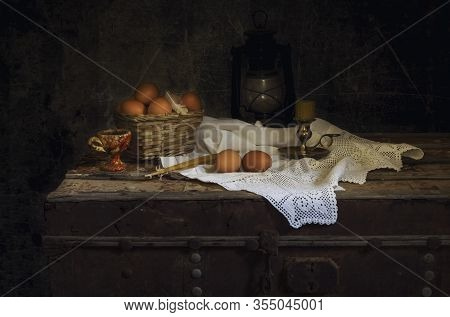 Easter Still Life. Wicker Basket With Eggs, Censer With Incense And Candles On A Vintage, Wooden Che
